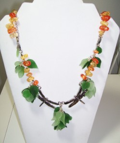 Dragonfly necklace, green leaf clusters, carnelian strand