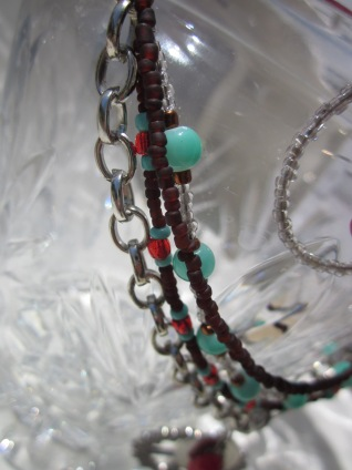 Bead strands closeup, peace sign necklace