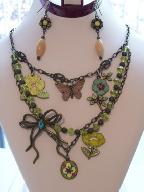 sparkle bow necklace, green beads, flower, butterfly charms
