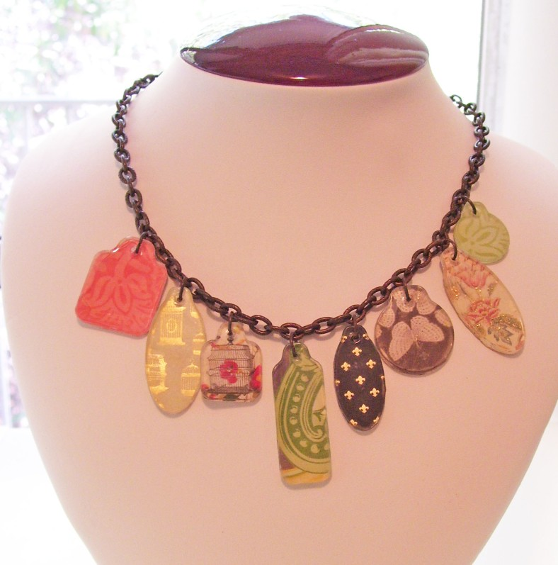 gold birdcage, grey butterfly, pink, green, scrapbook tags necklace