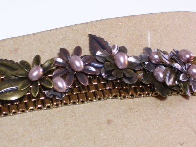 cuff bracelet, bronze beads, metal flowers