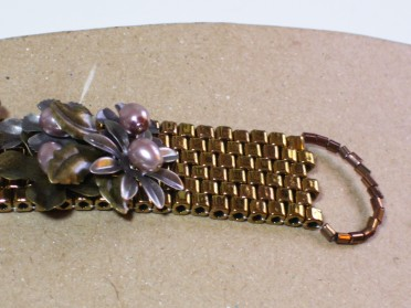 bracelet, cuff, bronze beads, metal flowers, end view