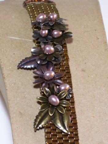 Bronze cuff bracelet, metal flowers, pearl centers image