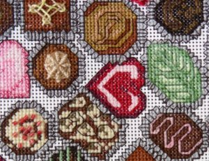 chocolate candies cross stitch design, truffles close up