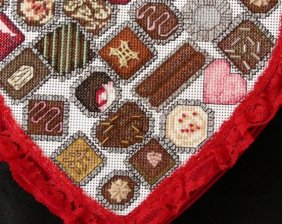Cross stitch chocolate candies in heart box 3D