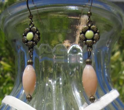 metal flower earrings, pale green, oval peach bead