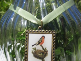 robin and nest bird charm, epoxy, antique bronze, green satin ribbon