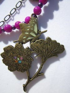 flower on butterfly charm pendant, antique bronze, rainbow