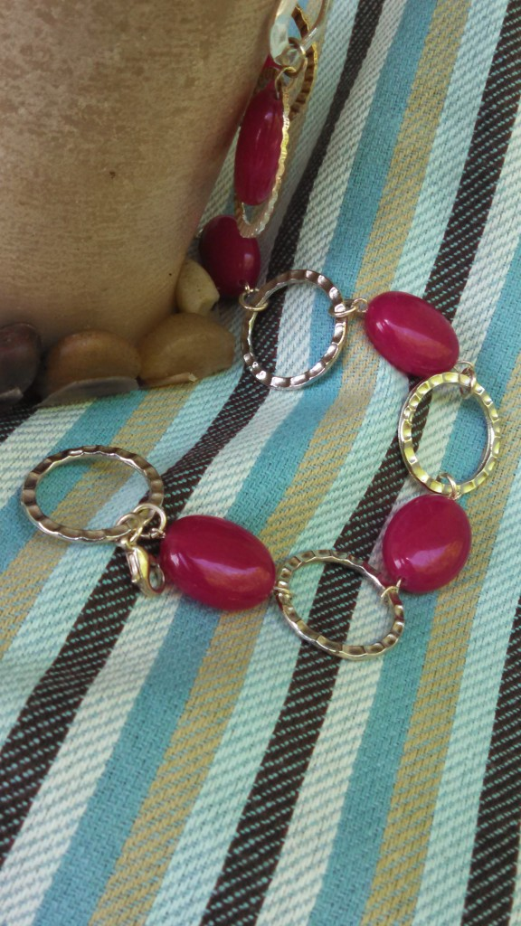 Bright pink stone bead and silver circle bracelet