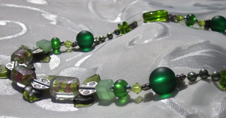 Front Necklace Closeup: pink flower lampwork beads, silver tone diamond beads, green leaf beads