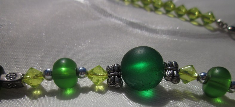 Emerald green round beads, silver tone butterfly beads, peridot bicone beads