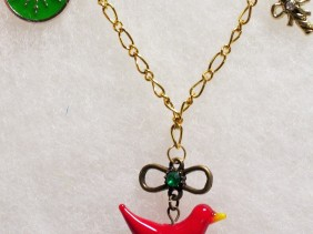 gold holiday necklace, red bird pendant